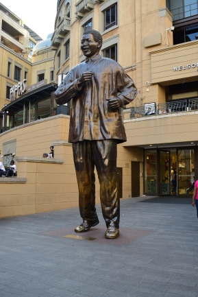 The Nelson Mandela statue in front at The Mandela Square mall.